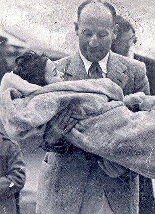 Irish doctor Robert Collis and his adopted son, Zoltan