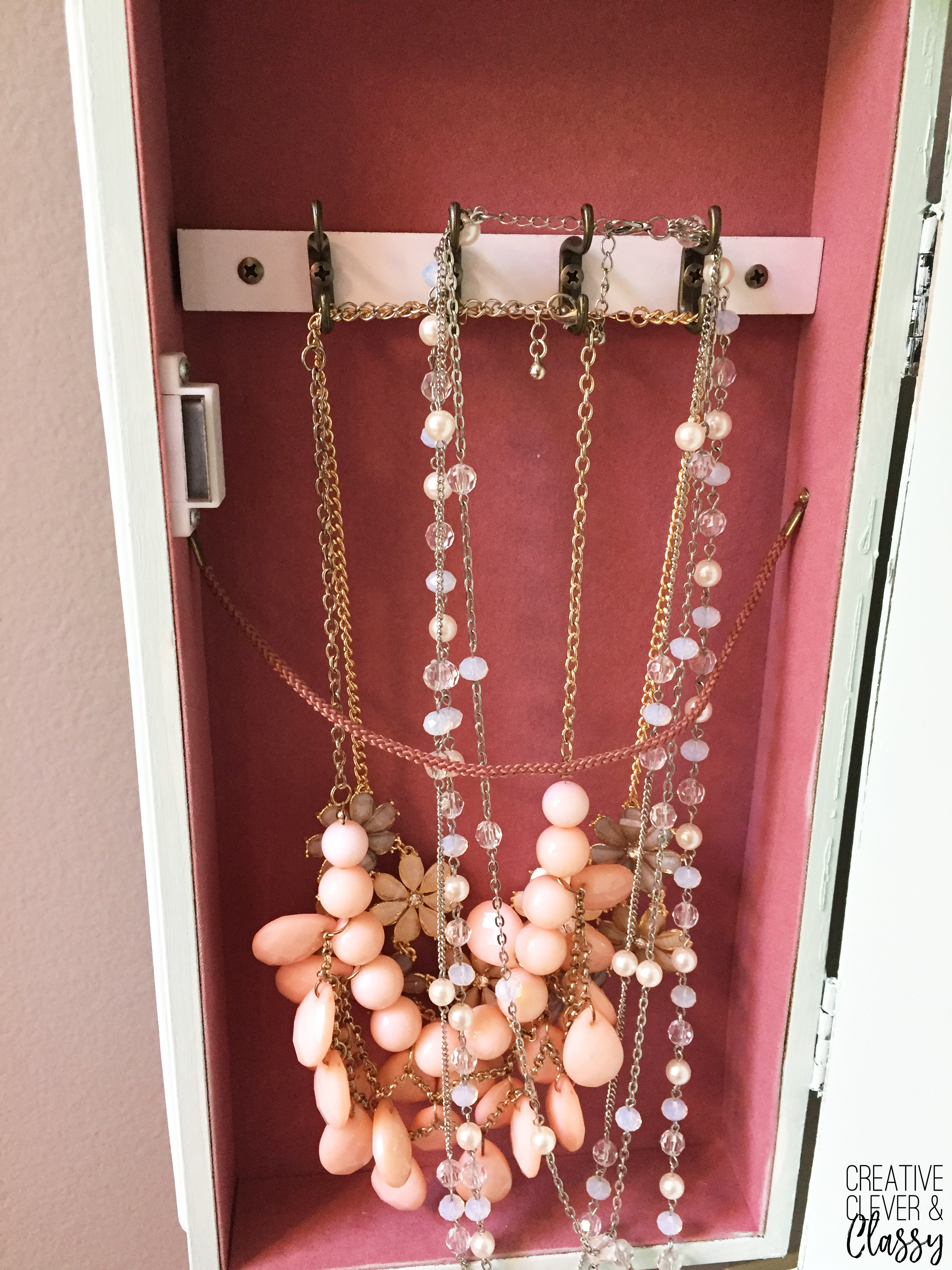 Necklace organization: I found a white jewelry armoire at a garage sale, and decided to give it a paint job. Here is a simple tutorial on how to paint furniture!